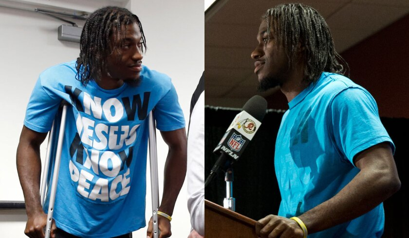 Washington quarterback Robert Griffin III turned his religious-themed shirt inside-out before addressing the media Sunday.