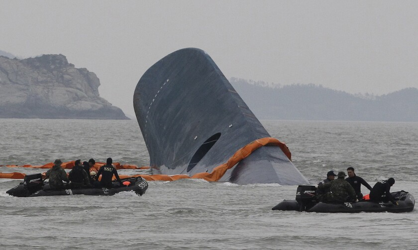 South Korean coast guard crews search for passengers aboard the sunken ferry Sewol in the waters off the southern coast of South Korea in April.