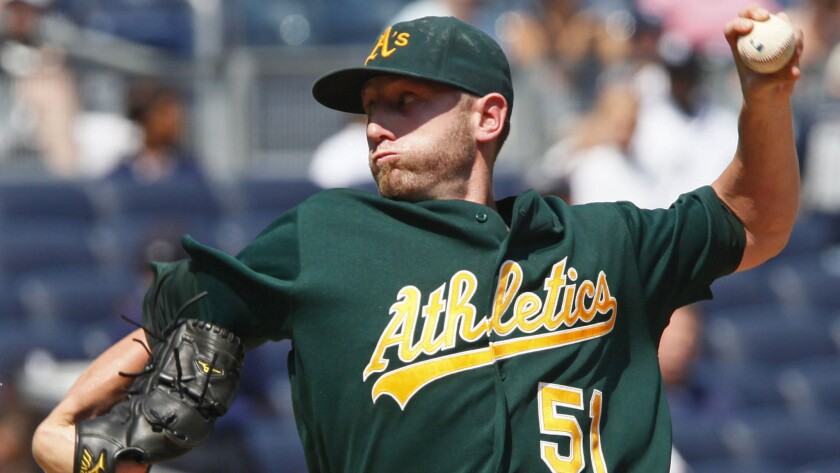 Oakland Athletics pitcher Dallas Braden delivers a pitch during a game against the New York Yankees in 2010. The former Oakland starter's short career included a perfect game on Mother's Day 2010.