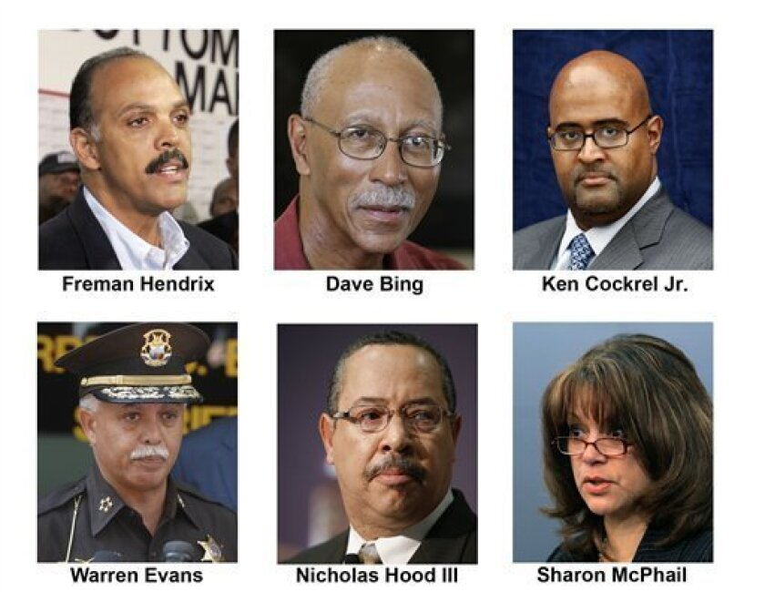 Candidates for the office of Detroit mayor are shown. Top row from left are Freman Hendrix, Dave Bing, and Ken Cockrel Jr. Bottom row from left are Warren Evans, Nicholas Hood III and Sharon McPhail. The city's former mayor is serving a four-month jail sentence. Its deficit could top $200 million.