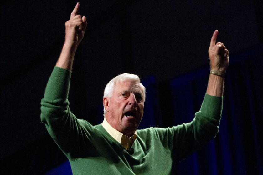 """Legendary retired college basketball coach Bobby Knight, nicknamed """"The General"""", gestures during his keynote speech on the power of negative thinking at the Response Expo 2013 at the Hilton San Diego Bayfront hotel in San Diego"""