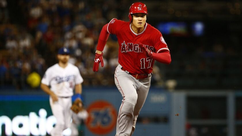 Angels pinch hitter Shohei Ohtani sprints for third base during a game at Dodger Stadium on July 13.