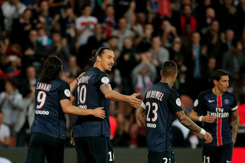 PSG's Zlatan Ibrahimovic, second from left, celebrates with teammate after scoring during their French League One soccer match against Toulouse, at the Parc des Princes stadium in Paris, France, Saturday, Nov. 7, 2015. (AP Photo/Thibault Camus)