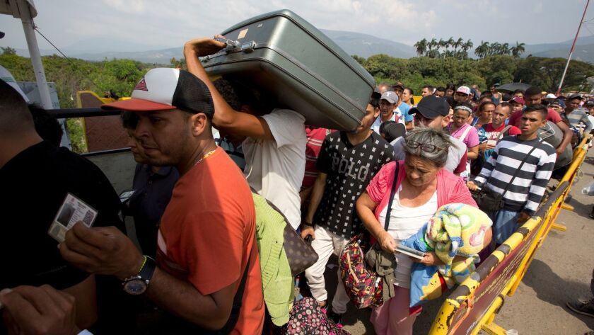 Venezuelans cross the Simon Bolivar International Bridge into Colombia.
