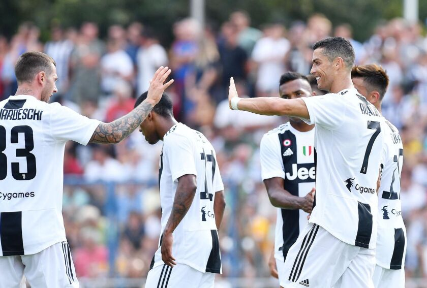 Juventus' Cristiano Ronaldo (R) celebrates with teammates during a soccer friendly match between Juvents A and Juventus B at Villar Perosa, Turin, 12 August 2018.
