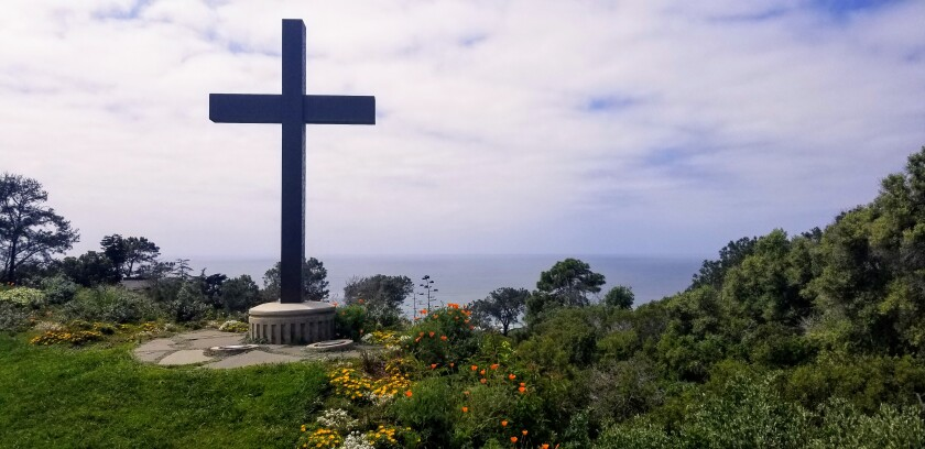This cross and ocean view is the first image students and visitors see when they enter the Point Loma Nazarene University campus.