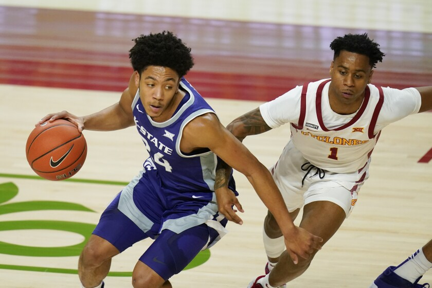 Kansas State guard Nijel Pack drives around Iowa State guard Tyler Harris, right, during the first half of an NCAA college basketball game, Tuesday, Dec. 15, 2020, in Ames, Iowa. (AP Photo/Charlie Neibergall)