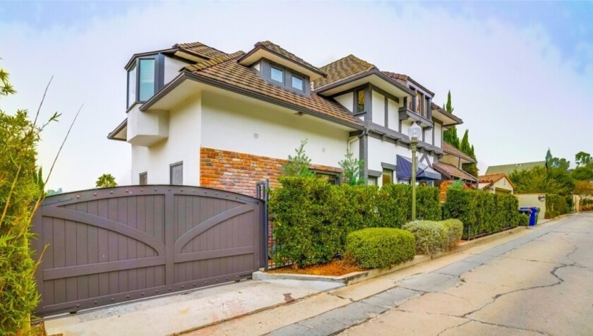 The Tudor-style spot has three bedrooms and 3.5 bathrooms in about 2,100 square feet.