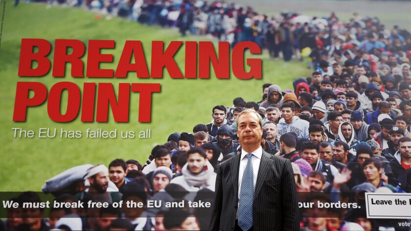 Right-wing parliament member Nigel Farage poses during the Brexit campaign in front of a poster depicting a crowd of refugees ostensibly headed for Britain. The poster was widely condemned.