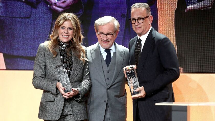 USC Shoah Foundation founder Steven Spielberg, center, with honorees Rita Wilson, left, and Tom Hanks at the Monday gala at the Beverly Hilton, which raised nearly $4 million to fund the organization's programs.