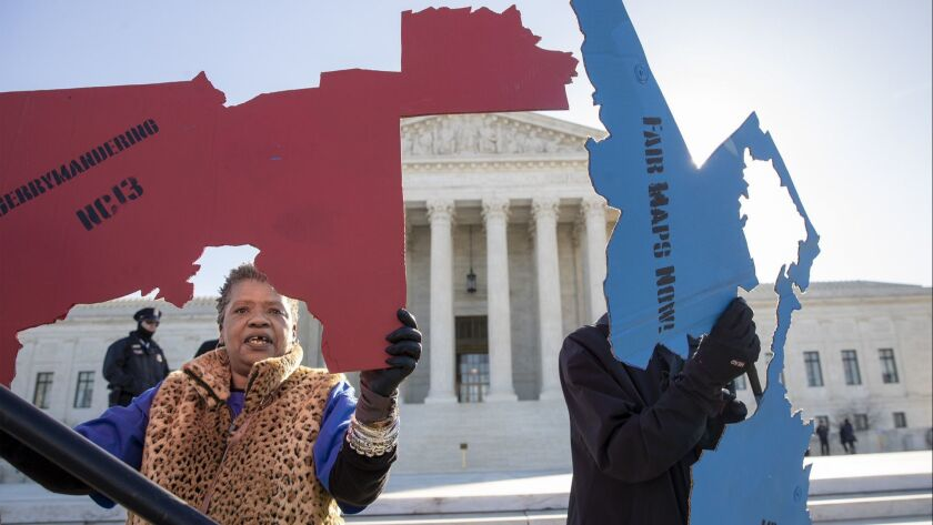 Activists at the Supreme Court opposed to partisan gerrymandering hold up representations of congres