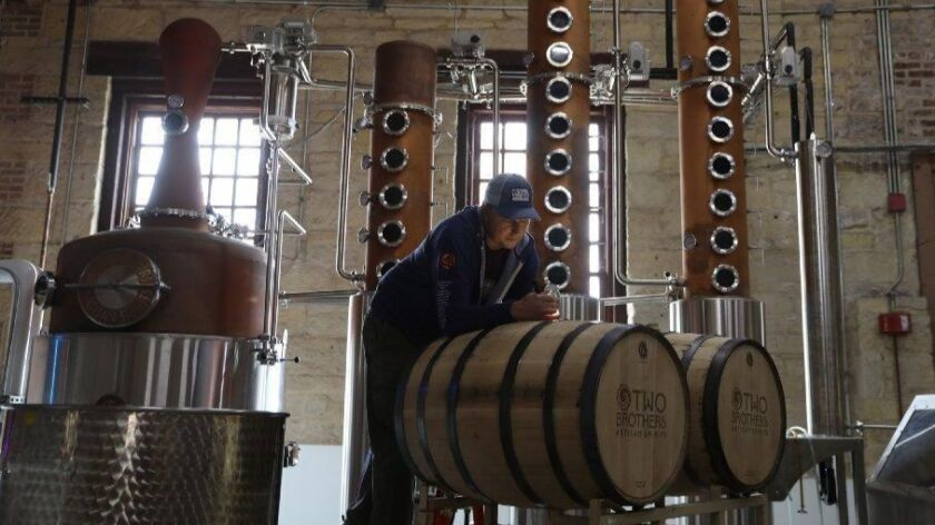 Jeremy Bogan, head distiller at Two Brothers Brewing, fills barrels with malt whiskey in Aurora on Nov. 1, 2018. In addition to brewing beer, the company is making spirits and roasting coffee.