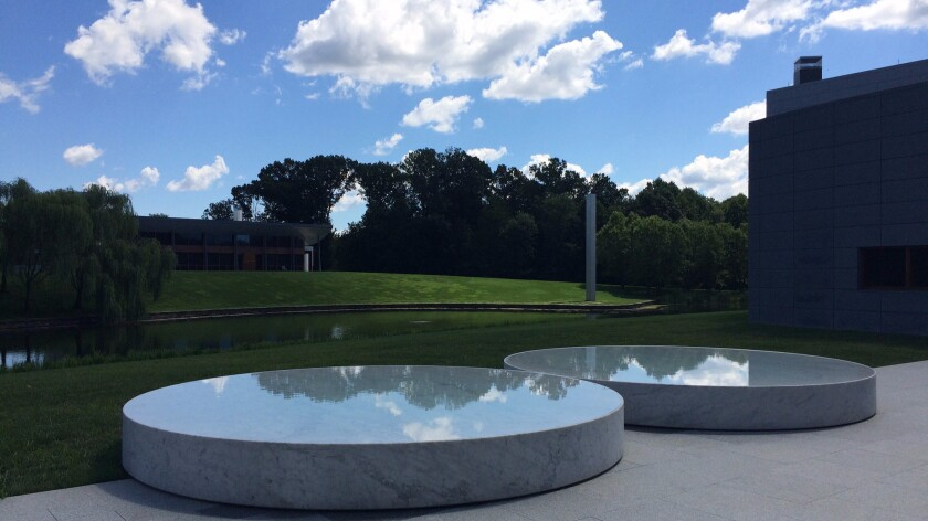 A pair of reflecting pools by Felix Gonzalez-Torres at Glenstone. Ellsworth Kelly's untitled tower can be seen in the distance.