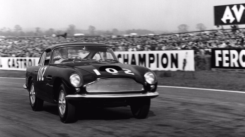 """Aston Martin will build a """"continuation"""" version of its historic DB4 G.T. race car, seen here at the Goodwood racetrack in England in 1960 driven by Stirling Moss."""
