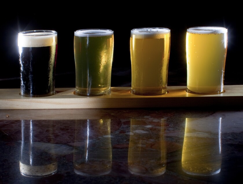 A taster flight of beer from Eagle Rock Brewery is shown. A new California law will allow breweries to give free samples of beer at farmers markets next year.