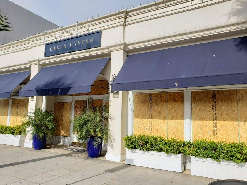 The Ralph Lauren shop at 7830 Girard Ave. in La Jolla was boarded up the morning of June 2.