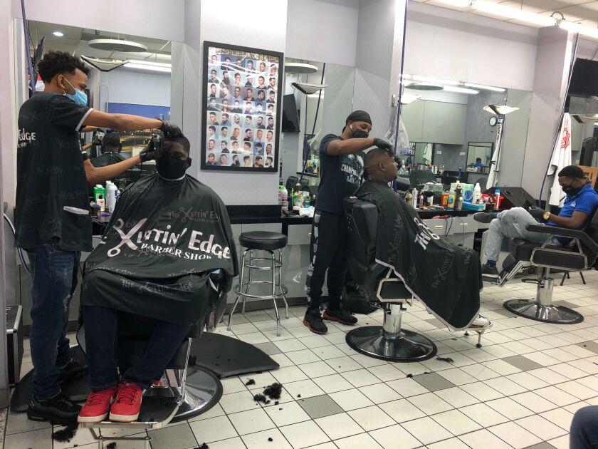 John James gets his hair cut at Kuttin' Edge barber shop in Houston's Galleria Mall.