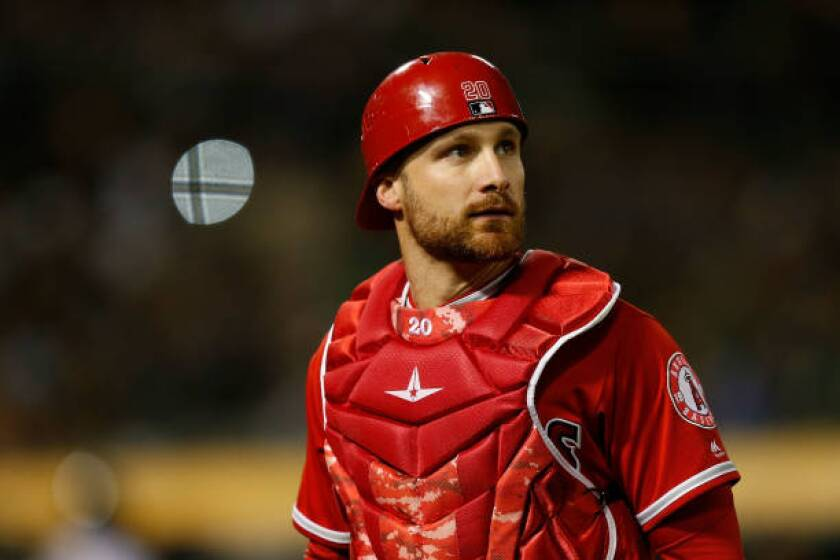 Angels catcher Jonathan Lucroy looks on during a game against the Oakland Athletics on March 30.
