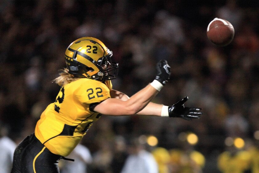 El Capitan receiver Zach Cagle (shown in a game earlier this season) caught a key touchdown pass from brother Brad Cagle in the Vaqueros' victory over Helix on Friday night.
