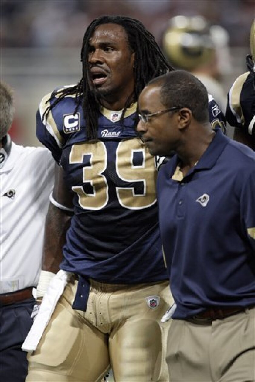St. Louis Rams running back Steven Jackson (39) is helped off the field after being injurd during the second quarter of an NFL football game against the Washington Redskins, Sunday, Sept. 26, 2010, in St. Louis. (AP Photo/Tom Gannam)