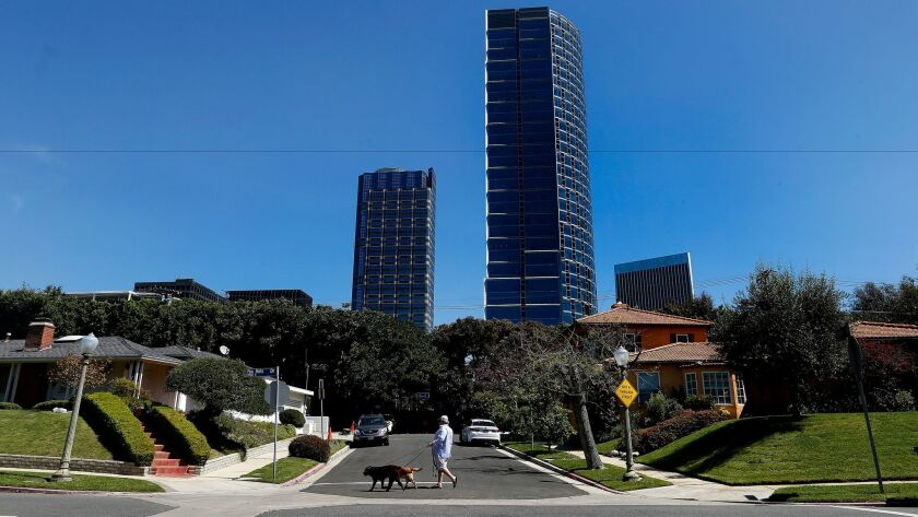 Century City skyscrapers rise above nearby homes. The area's homeowners association is in a legal fight with another nonprofit group over $3.1 million paid by the Century City mall owner as it sought to clear the way for possible changes to its parking fees.