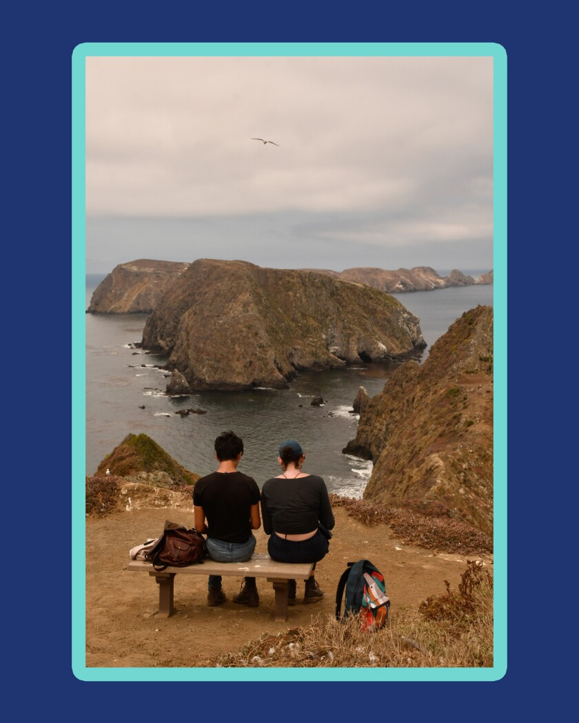 People look at Anacapa Island from Inspiration Point.