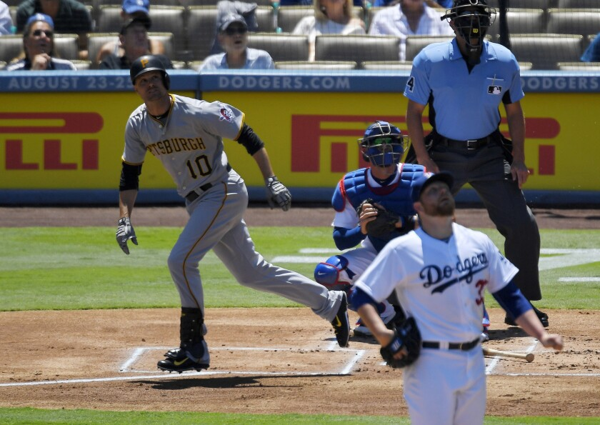 Pirates infielder Jordy Mercer runs to first after hitting a two-run home run against Dodgers starting pitcher Brett Anderson, lower right, during the first inning.