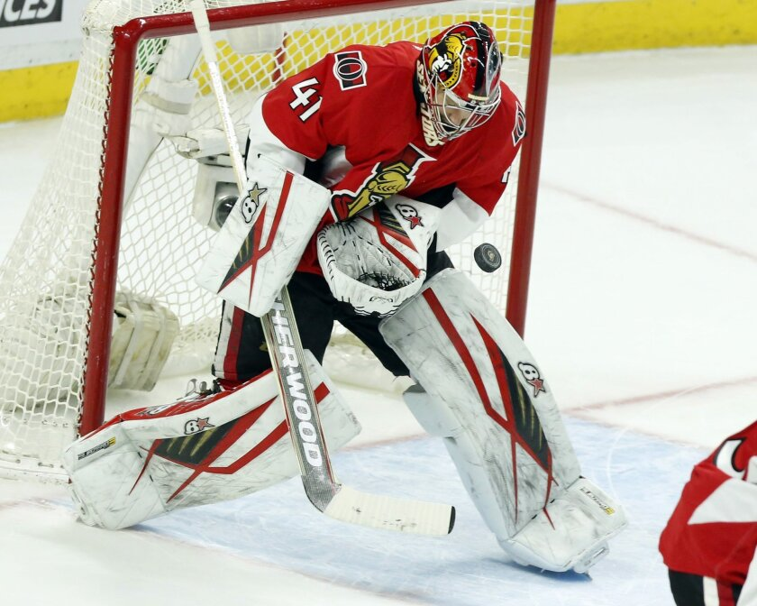Ottawa Senators' goalie Craig Anderson (41) makes a chest save during the second period of an NHL hockey game against the Toronto Maple Leafs, Saturday, Feb. 6, 2016, in Ottawa, Ontario. (Fred Chartrand/The Canadian Press via AP) MANDATORY CREDIT