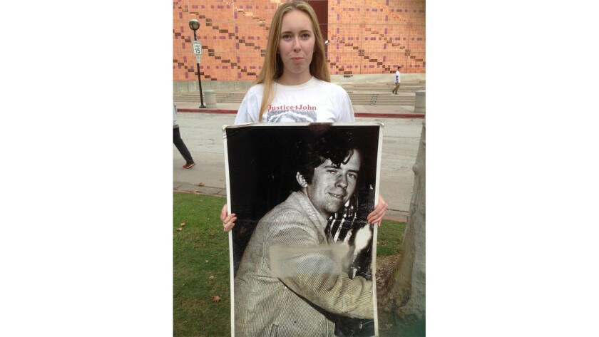 John McGraham, seen in a portrait held by his niece, Haley Graham Paisley, 14, Saturday at the United Way's eighth annual HomeWalk at Exposition Park, was burned to death in 2008 by a man with a vendetta against the homeless.