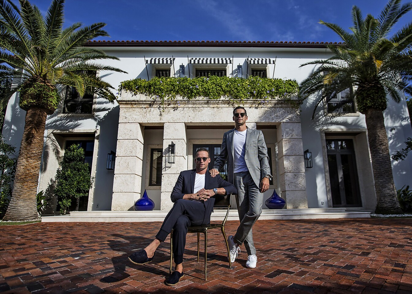 Real estate brokers Tal, left, and Oren Alexander at their home on Miami Beach.