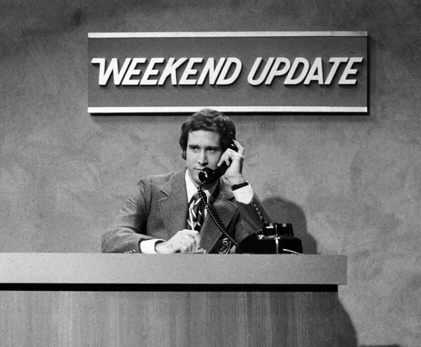 """Chevy Chase performs during a """"Weekend Update"""" sketch on """"Saturday Night Live"""" in New York on Oct. 11, 1975, during the show's premiere."""