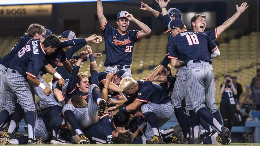 Cypress players celebrate after defeating Harvard-Westlake in the Southern Section Division 1 championship baseball game Saturday.