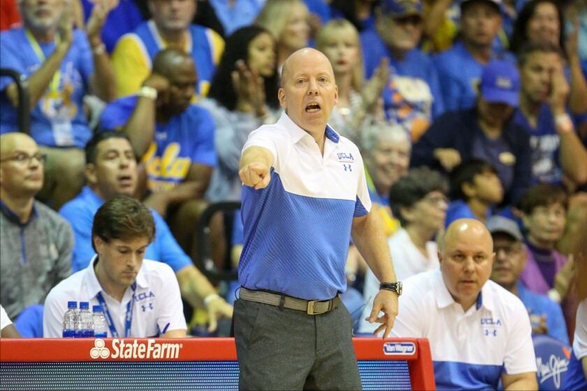 UCLA coach Mick Cronin directs his players during the first half of a game against Brigham Young on Nov. 25 at the Maui Invitational.