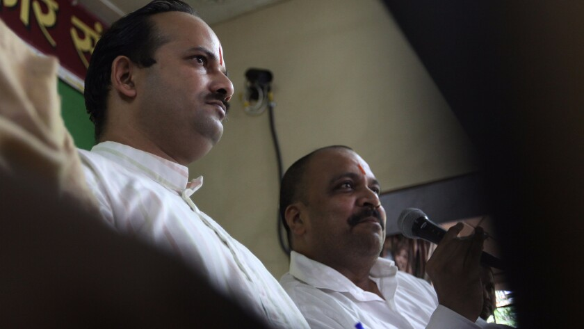 Sanatan Sanstha spokesperson Abhay Vartak and Hindu Vidhidnya Parisad secretary Sanjeev Punalekar addressing a press conference in 2013 in Mumbai, India.