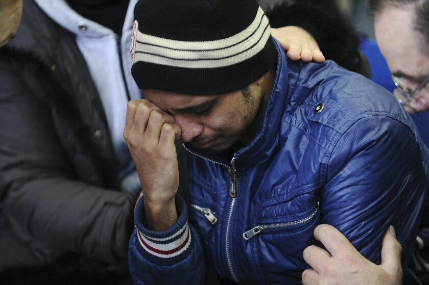 A relative of the plane crash victim sobs as he is comforted by other relatives at the Rostov-on-Don airport, about 950 kilometers (600 miles) south of Moscow, Russia Saturday, March 19, 2016. An airliner from Dubai crashed early Saturday while landing in the southern Russian city of Rostov-on-Don in strong winds, Russian officials said. (AP Photo)
