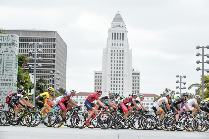 Fitness tracking app Strava bestows a virtual crown to the fastest riders completing specific routes. Above, racers in the Amgen Tour of California in downtown L.A. last year.