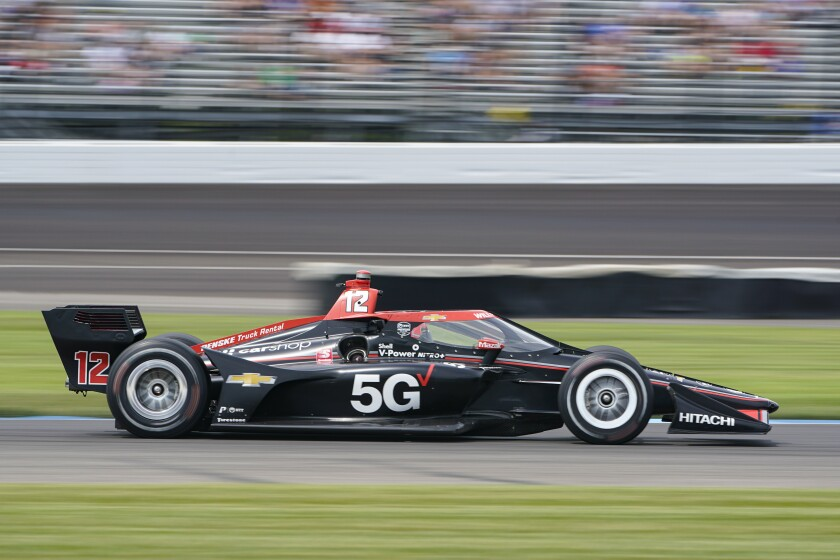 Will Power, of Australia, drives though a turn during the IndyCar auto race at Indianapolis Motor Speedway in Indianapolis, Saturday, Aug. 14, 2021. (AP Photo/Michael Conroy)