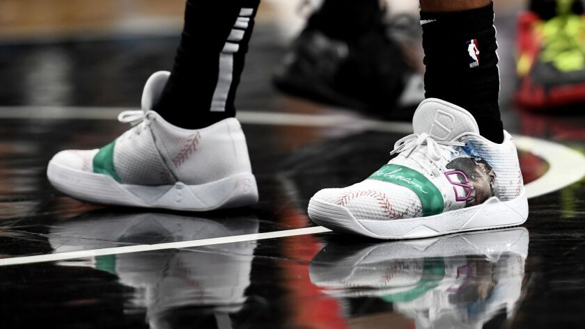 Spencer Dinwiddie wears sneakers honoring former Brooklyn Dodger Jackie Robinson during the first quarter of a game at Barclays Center in New York last month.