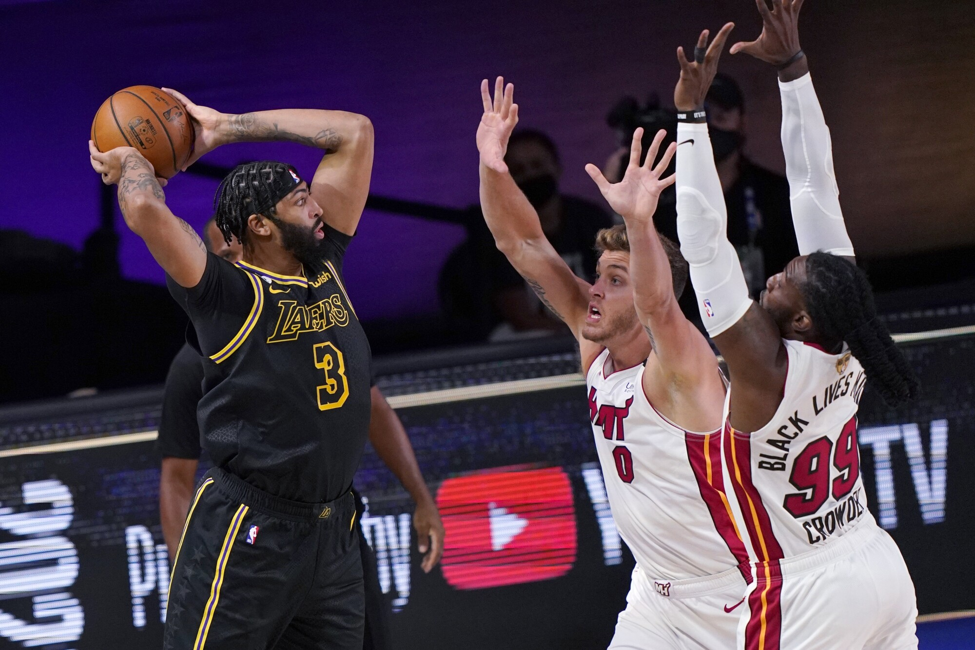 Lakers forward Anthony Davis looks to pass after grabbing a rebound against the Heat in Game 2.