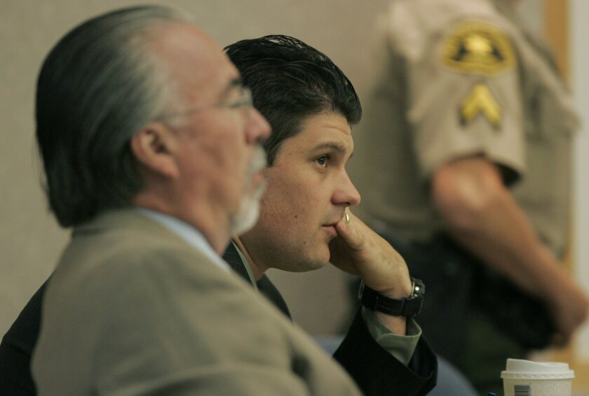 Frank White (right) listened to testimony yesterday with Charles Battle, an investigator for his attorney.