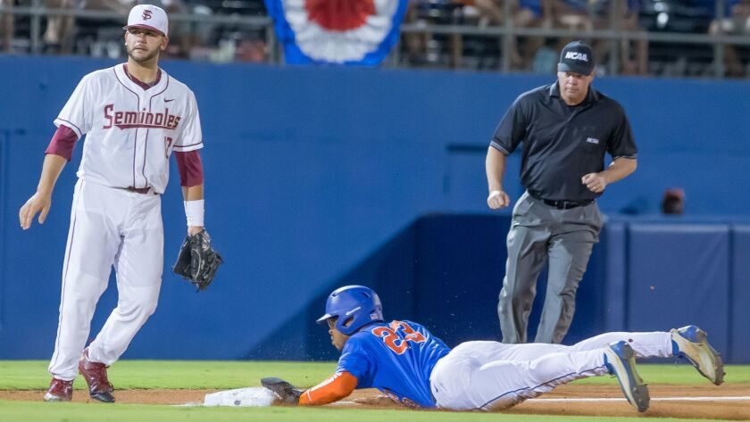 Florida outfielder Buddy Reed (23) steals third base during an NCAA super regional baseball game against Florida State on June 12 in Gainesville, Fla.