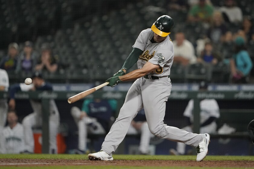 Oakland Athletics' Matt Olson hits a two-run single during the seventh inning of the team's baseball game against the Seattle Mariners, Tuesday, June 1, 2021, in Seattle. (AP Photo/Ted S. Warren)