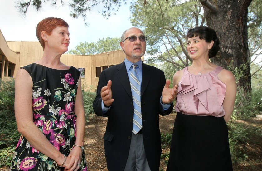Dr. Geoffrey Wahl, a Salk Institute scientist, explains upcoming research with sisters Leah Lundien Harlig, left, and Bianca Lundien Kennedy at a news conference Thursday.