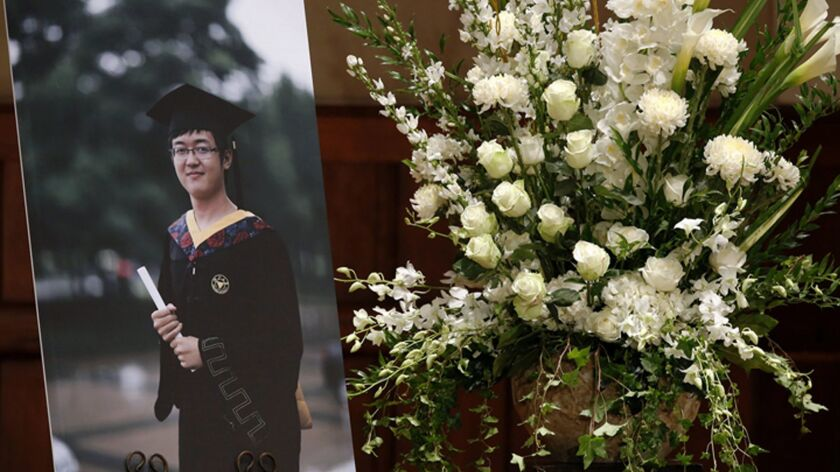 FILE - This Aug. 1, 2014 file photo shows a portrait of University of Southern California graduate s