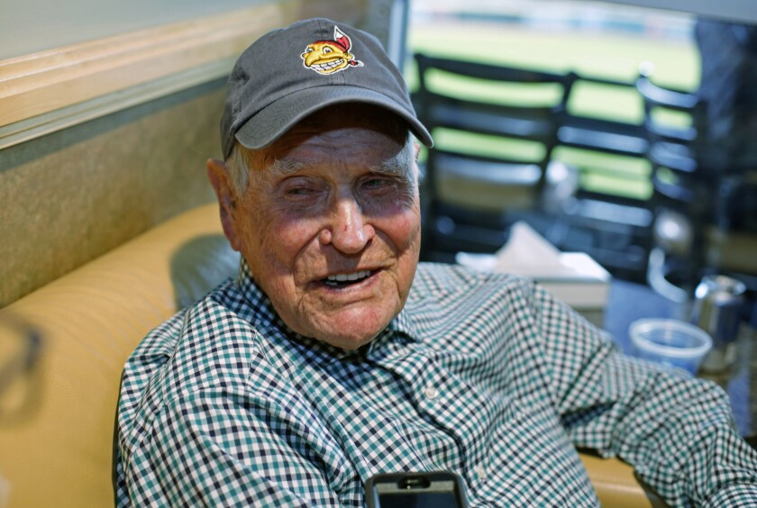 FILE - In this Tuesday, Nov. 1, 2016 file photo, Eddie Robinson sits in a box at Progressive Field before Game 6 of the Major League Baseball World Series against the Chicago Cubs in Cleveland. Former big leaguer and general manager Eddie Robinson, who was the oldest living former MLB player, has died at age 100. The Texas Rangers, the team for which Robinson was GM from 1976-82, said he passed away Monday night, Oct. 4, 2021 at his ranch in Bastrop, Texas.(AP Photo/Gene J. Puskar)