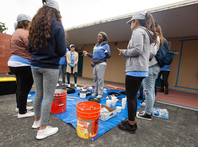 Aminata Diagne  of Pasadena  leads a group of volunteers during the day of service at Orville Wright STEAM Magnet.