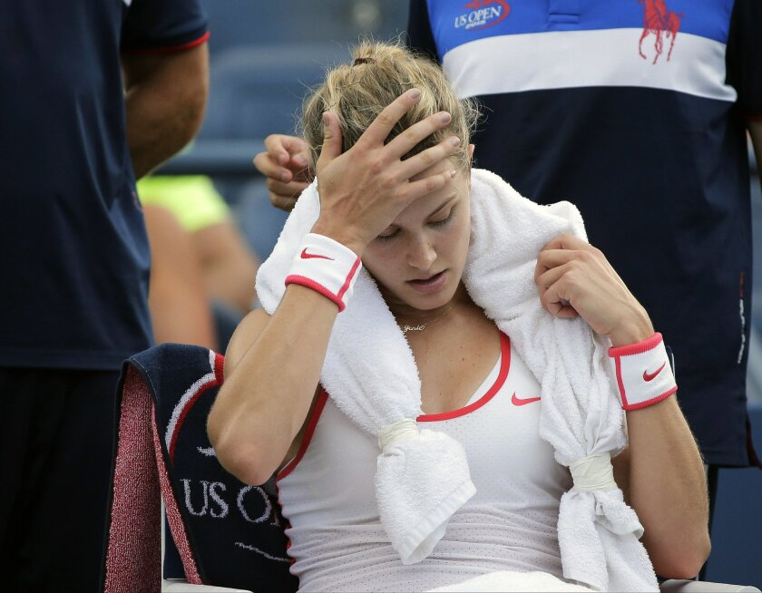 FILE - In this Sept. 4, 2015, file photo, Eugenie Bouchard, of Canada, takes a break between games against Dominika Cibulkova, of Slovakia, at the U.S. Open tennis tournament in New York. Bouchard won that match. Bouchard fell at the facility and suffered a concussion, and withdrew before her fourt