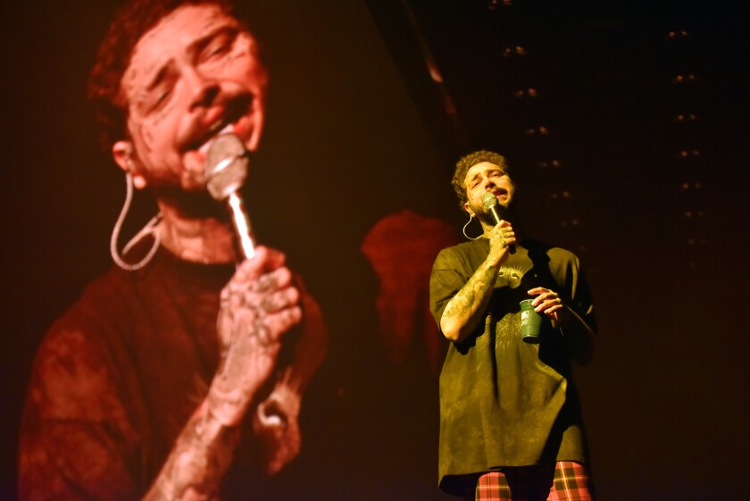 "Post Malone performs during the ""Runaway Tour,"" at the Allstate Arena, Tuesday, Feb. 11, 2020, in Rosemont, Ill. (Photo by Rob Grabowski/Invision/AP)"