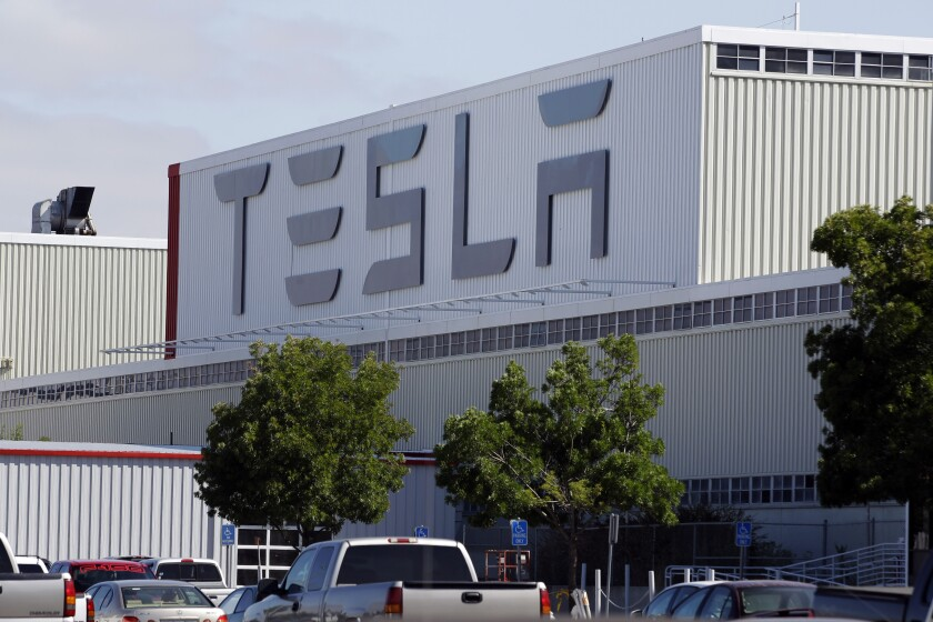 FILE -This June 22, 2012, file photo, shows an exterior view of the Tesla factory in Fremont, Calif.