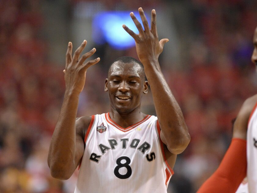 Toronto Raptors' Bismack Biyombo reacts after being called for a foul against the Cleveland Cavaliers during the first half of Game 6 of the NBA basketball Eastern Conference finals, Friday, May 27, 2016, in Toronto. (Frank Gunn/The Canadian Press via AP)